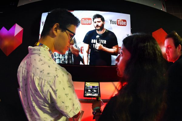 "Gamers discuss a tablet computer demonstrating YouTube's venture into game streaming called ""YouTube Gaming"" on the second day of the Electronic Entertainment Expo, known as E3 at the Convention Center in Los Angeles, California on June 17, 2015. YouTube said it is creating an online arena devoted to video game play, jumping onto a hot ""e-sports"" trend and challenging Amazon-owned Twitch. YouTube Gaming will debut in Britain and the United States in the coming months. AFP PHOTO / MARK RALSTON (Photo credit should read MARK RALSTON/AFP/Getty Images)"